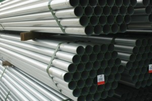 Stacked metal pipes at a construction site